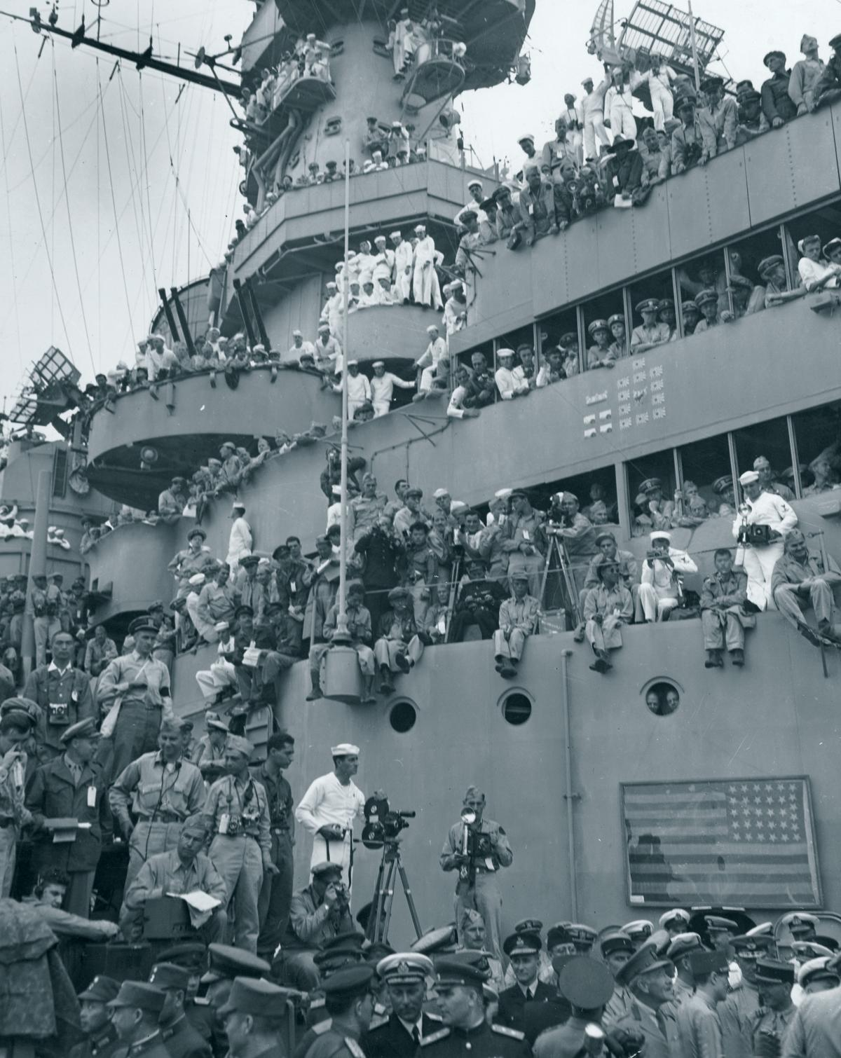 Front row seat to history: Sailors crowd the decks of the USS Missouri in Tokyo Bay to witness the formal Japanese surrender proceedings on 2 September 1945.