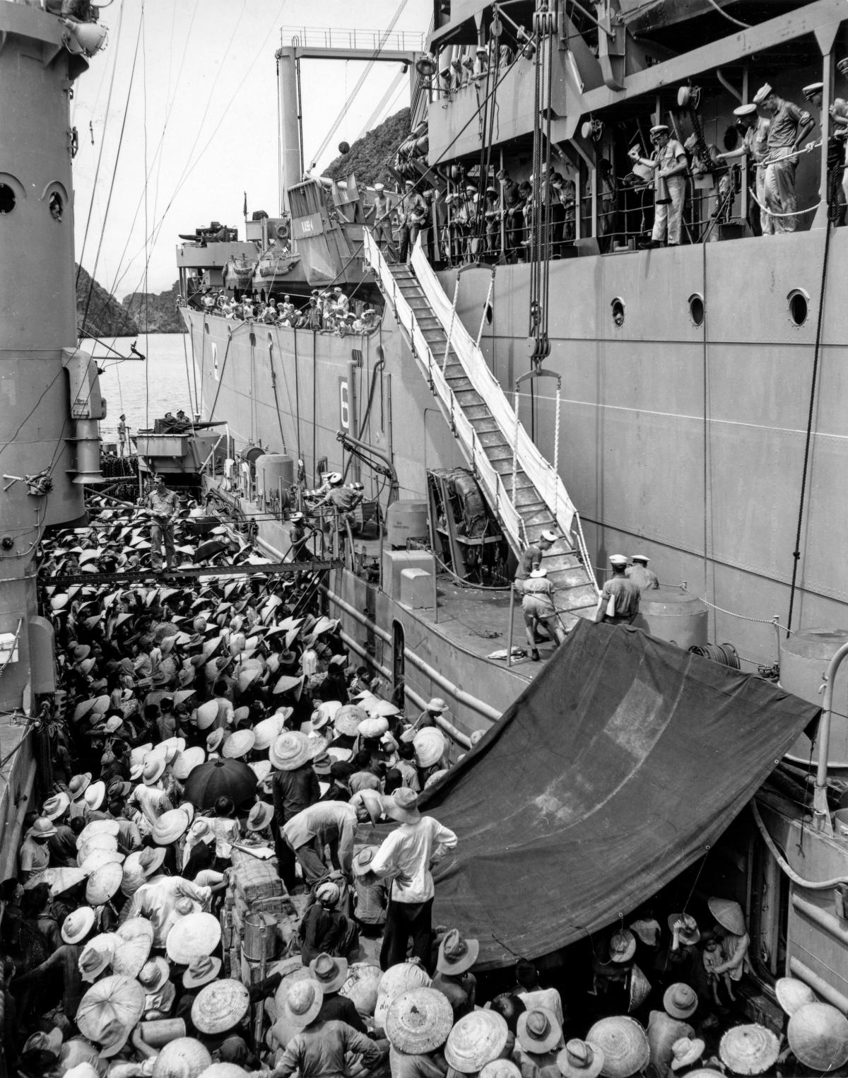 Voting with their Feet: Vietnamese refugees are transferred from a French ship to the USS Montague (AKA-98) during Operation Passage to Freedom.