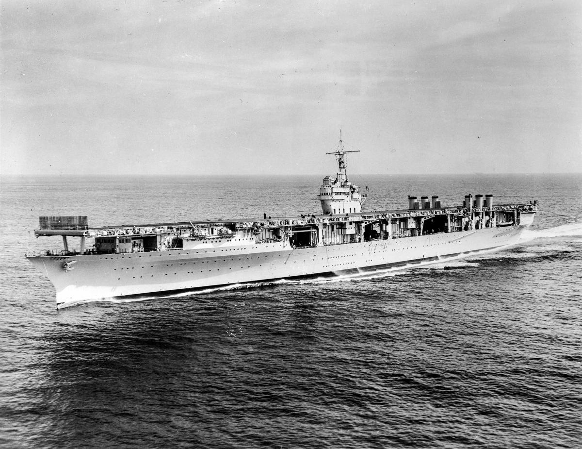 Aerial port quarter view of the USS Ranger (CV-4) underway