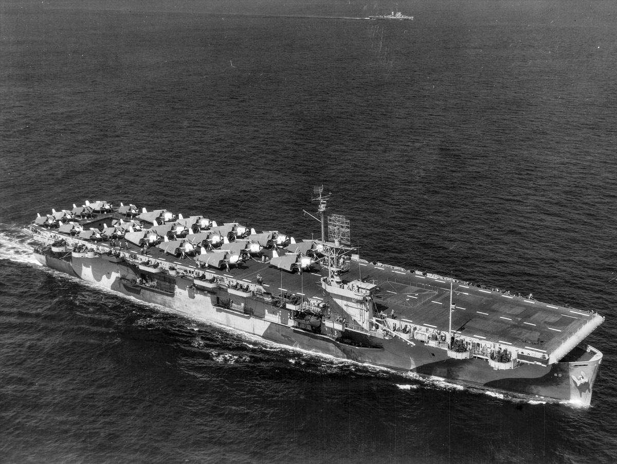 Aerial starboard bow view of the USS Guadalcanal (CVE-60) underway in the Atlantic Ocean