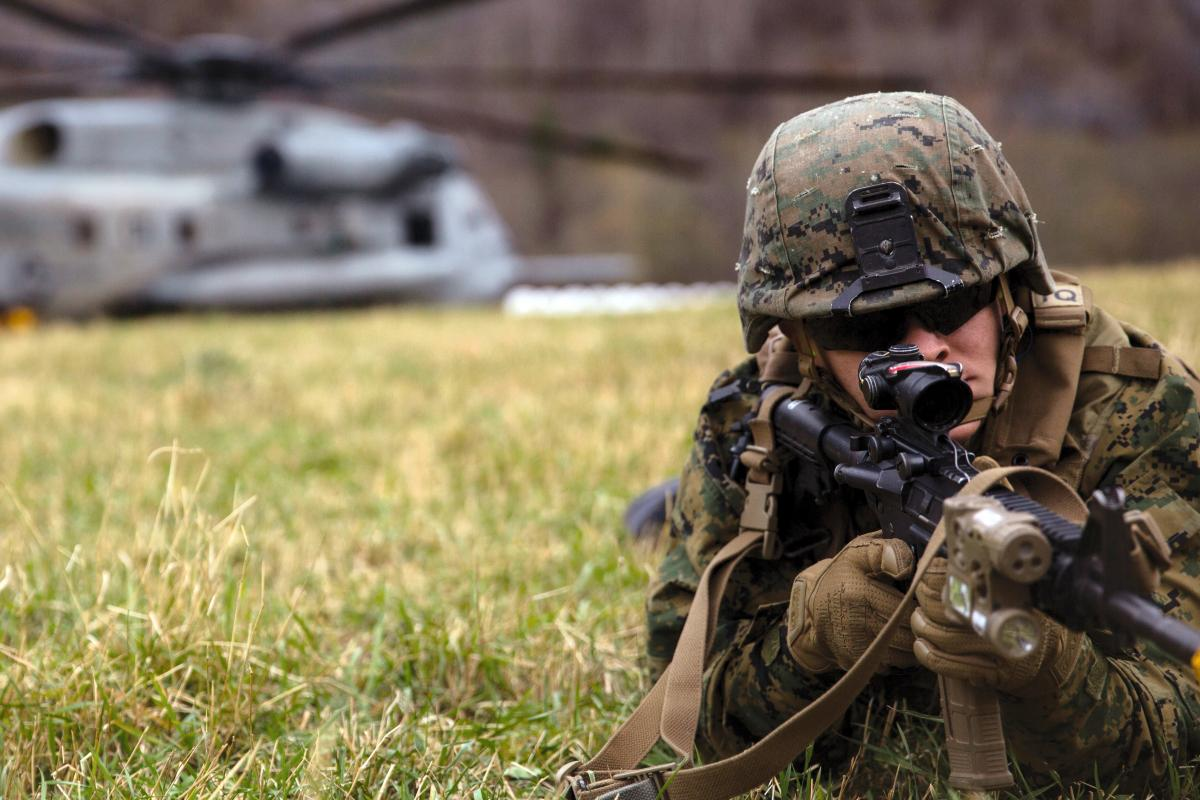 A Marine posts security after disembarking a CH-53E Super Stallion in Gjora, Norway during an air assault in support of Trident Juncture 18, Oct. 31, 2018