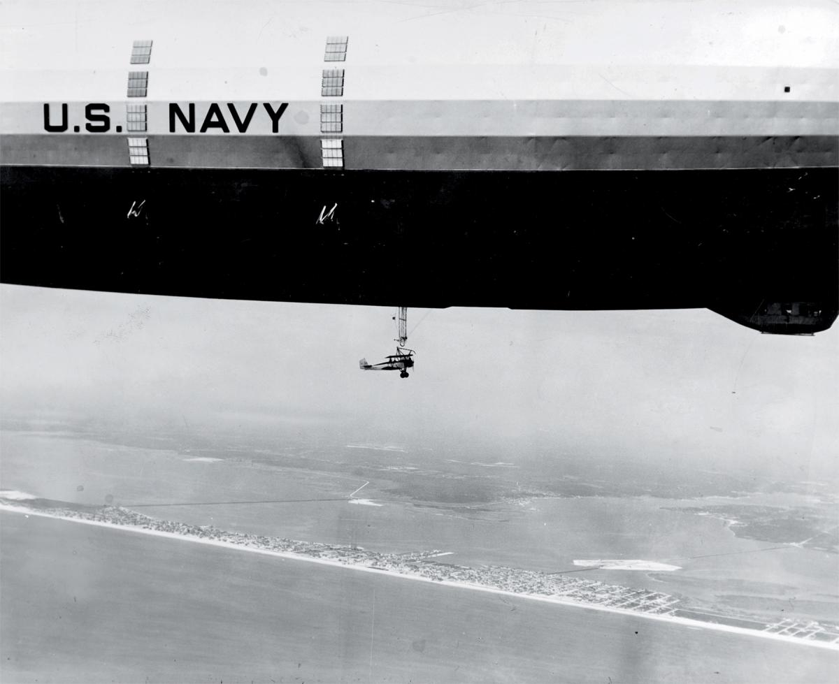 Waco N2Y-1 hooking on to the trapeze of USS Akron (ZRS-4)