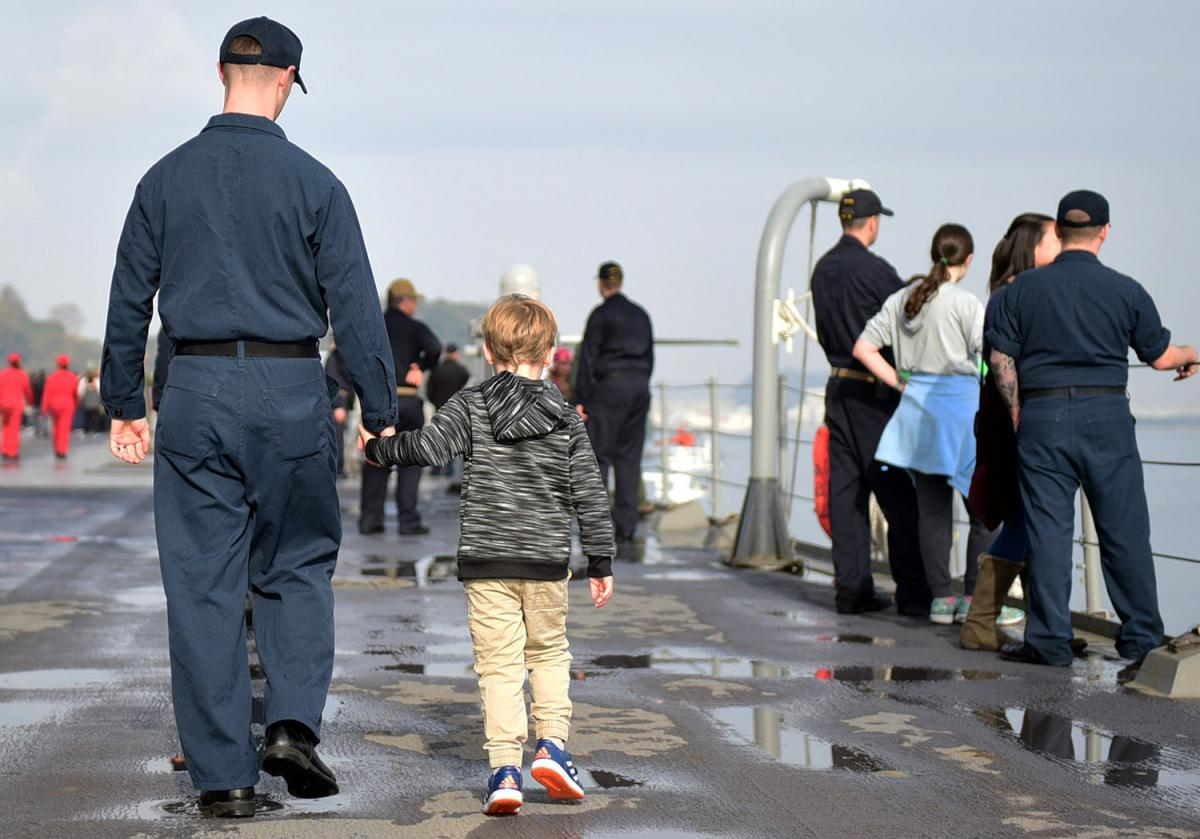 Hospital Corpsman 1st Class Nicholas Belflower, attached to U.S. 7th Fleet Flagship USS Blue Ridge (LCC 19), walks the main deck with his son during the ship's first Family Day Cruise in December 2018
