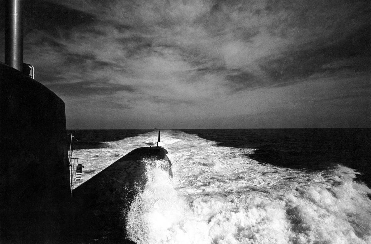 View looking aft down the port side of the USS Sam Houston (SSBN-609) underway in September 1962