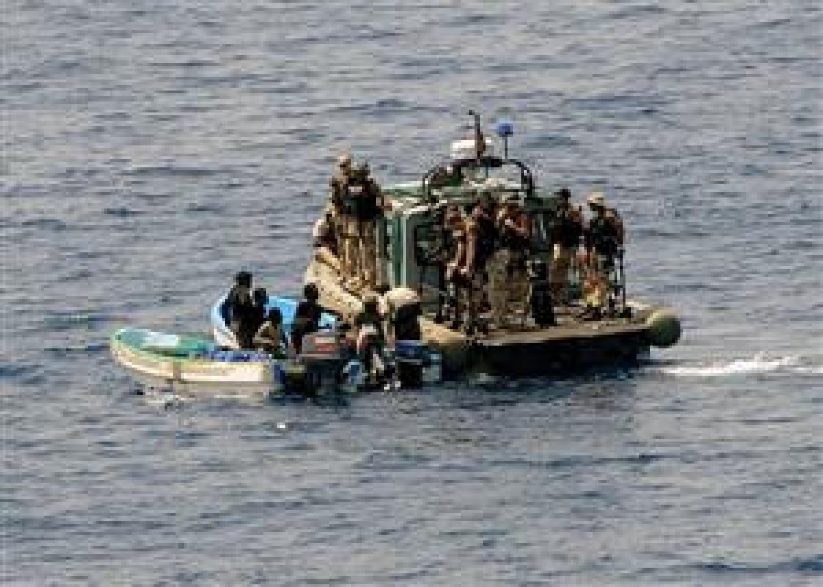 A visit, board, search, and seizure team from the USS Ashland (LSD-48) board and inspects two fishing skiffs for suspected pirate activity on 6 May. At some point soon, the author says, the United States must assess various courses of action to alleviate