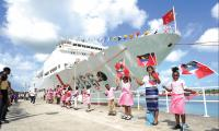 Students welcome the Chinese naval hospital ship Ark Peace at St. John's, capital of Antigua and Barbuda, on Oct. 22, 2018