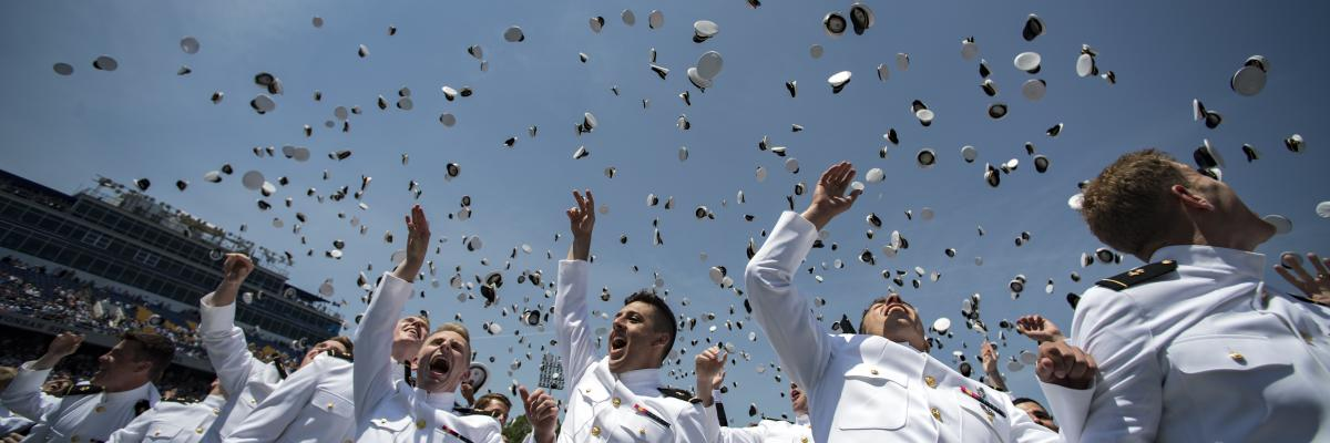 Newly-Commissioned ensigns at the U.S. Naval Academy throwing their hats into the air at commencement.
