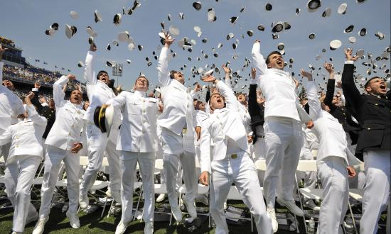 Newly commissioned Navy Ensigns and Marine 2nd Lieutenants from the U.S. Naval Academy Class of 2016 throw their midshipmen covers in the air at the end of their graduation and commissioning ceremony May 27 at the Navy-Marine Corp Memorial Stadium