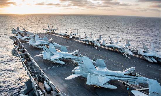 Aircraft from Carrier Air Wing (CVW) 2 sit on the flight deck of the Nimitz-class aircraft carrier USS Carl Vinson (CVN 70)