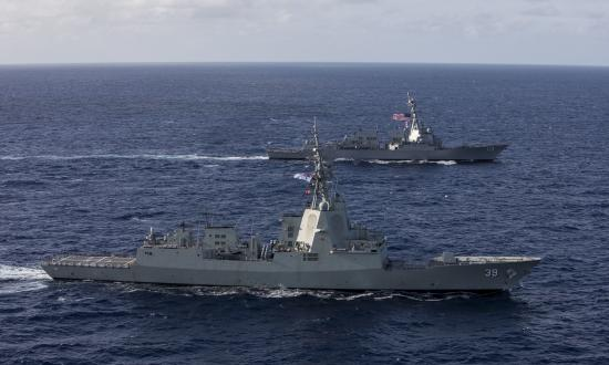 Aerial oblique starboard view of HMAS Hobart (DDG-39) sailing with the USS John Finn (DDG-113)