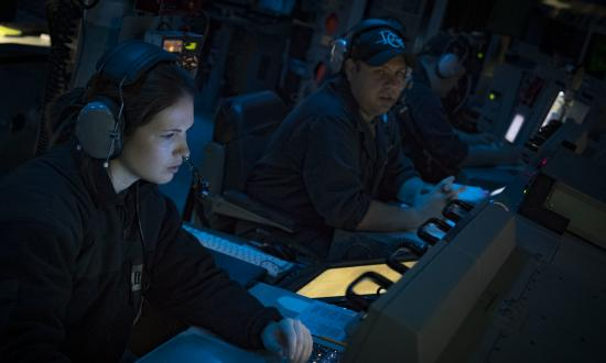 Lieutenants standing watch in the CIC of the USS Donald Cook (DDG-75)
