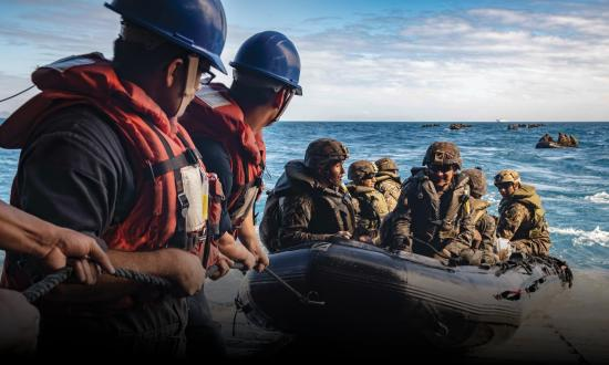 Sailors man a safety line as Marines with the 31st Marine Expeditionary Unit (MEU) stand fast on the stern gate during Combat Rubber Raiding Craft (CRRC) operations aboard the amphibious dock landing ship USS Ashland (LSD-48)