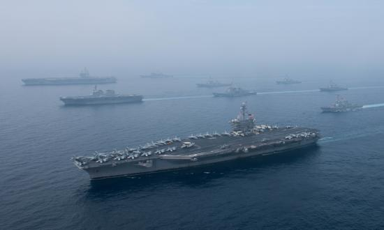 Aerial view of the Carl Vinson Carrier Strike Group and JMSDF conducting training exercises in the sea of Japan