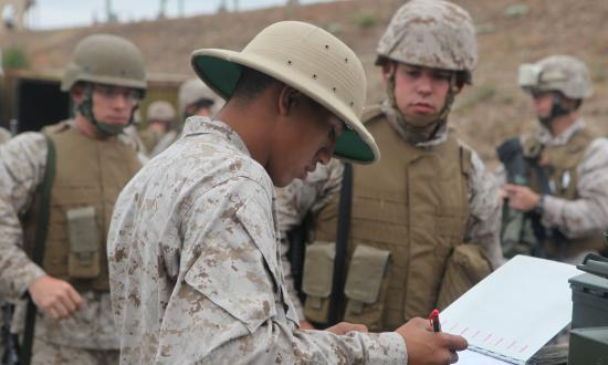 A rifle range instructor prepares to train Marines