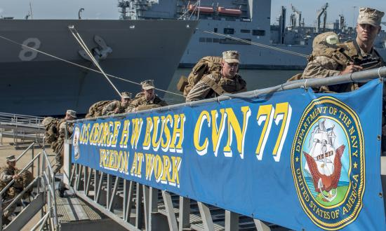 Marines board the USS George H. W. Bush (CVN-77) in Norfolk, Virginia, for ship-familiarization training.