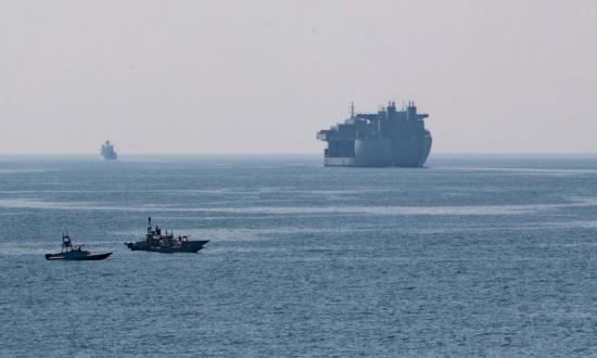 Iranian small boats frequently harrass U.S. Navy ships in the Arabian Gulf, most recently in a widely publicized series of incidents in April 2020. Here, several Iranian boats observe the USS Lewis B. Puller (ESB-3) during her passage through the Strait of Hormuz.
