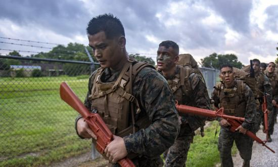 U.S. Marine Corps Reservists hike during a culminating event at Naval Air Station Joint Reserve Base New Orleans on May 23, 2019