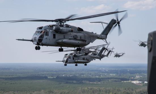 Six U.S. Marine Corps CH-53E Super Stallion helicopters in flight