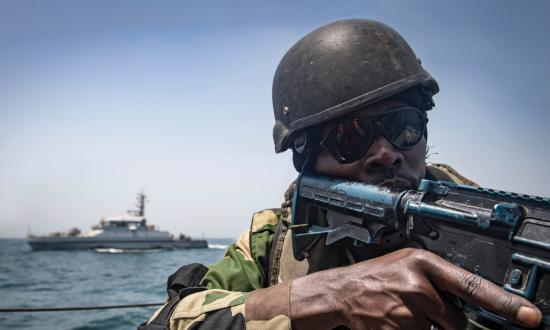 A Senegalese sailor participates in a visit, board, search and seizure training scenario aboard the Gambian navy GNS Kuntah Kinteh during Exercise Obangame Express 2019