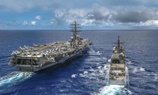 The USS Ronald Reagan (CVN-76) and the USS Antietam (CG-54).