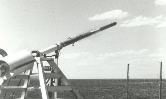 An April 1980 test of the Self-Initiating Antiaircraft Missile (SIAM) developed by the Defense Advanced Research Projects Agency. The missile was fired from a test stand at the White Sands Missile Range in New Mexico and intercepted a Gyrodyne QH-50 Drone Antisubmarine Helicopter (DASH). The test missile lacked a warhead but successfully intercepted the unmanned helicopter (insets)