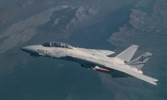 An F-14D Tomcat fighter aircaft from VF-124 flying over California.