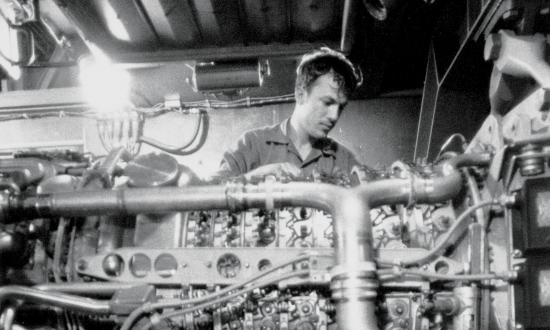 A crewman on board the USS Fletcher (DD-992) performs maintenance on one of the ship's gas-turbine engines. Gas turbines—the most prevalent form of propulsion on board Navy ships today—combine the functions of the boiler and the turbine into one element and do not need feedwater.