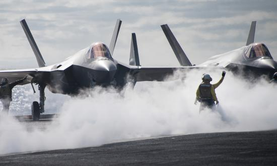 "Sailors directing an F-35C Lightning II multirole fighter aircraft assigned to the ""Argonauts"" of Strike Fighter Squadron (VFA) 147 on the flight deck of the aircraft carrier USS Carl Vinson (CVN-70) in December 2018."