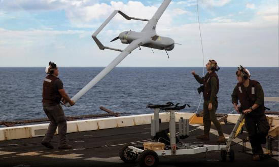 Marines with Marine Medium Tiltrotor Squadron 365 Reinforced lower an RQ-21A Blackjack unmanned aerial surveillance aircraft down from the STUAS recovery system using the vertical capture rope as the 24th Marine Expeditionary Unit and USS Mesa Verde (LPD-19).