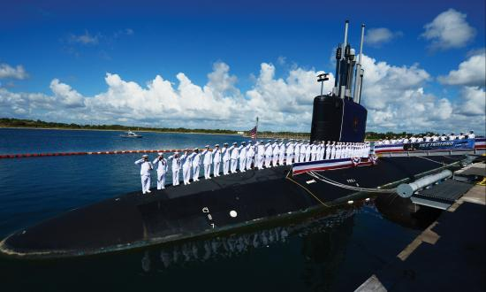 The crew of the USS Indiana (SSN-789) salute after bringing the boat to life after her commissioning.