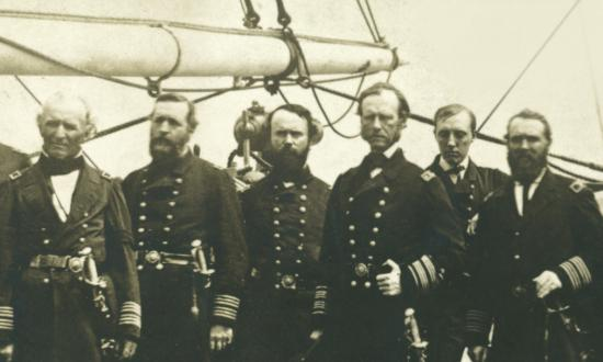 Rear Admiral John Dahlgren standing with his staff on board the sloop-of-war Pawnee off the Georgia coast in 1865
