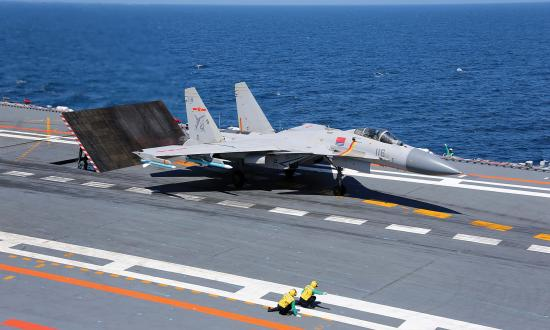 A J-15 Flying Shark fighter prepares for launch from the Liaoning.