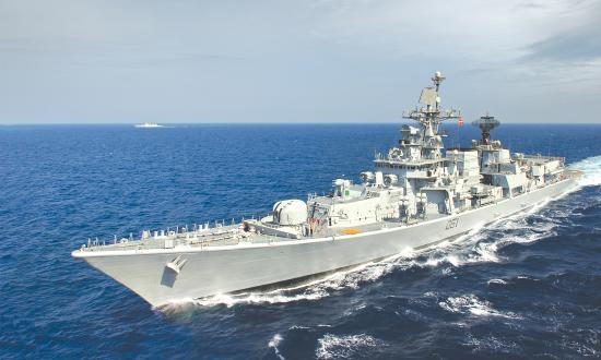 Port bow view of INS Delhi underway at sea.