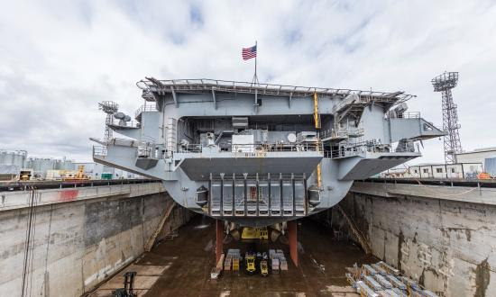 The aircraft carrier USS Nimitz (CVN 68) is seen in Dry Dock 6 after dewatering at Puget Sound Naval Shipyard & Intermediate Maintenance Facility in Bremerton, Wash., March 5, 2018