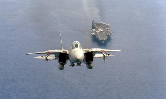 ront air-to-air view of an F-14A Tomcat aircraft from Fighter Squadron 102 (VF-102), just after taking off from the aircraft carrier USS AMERICA (CV-66)