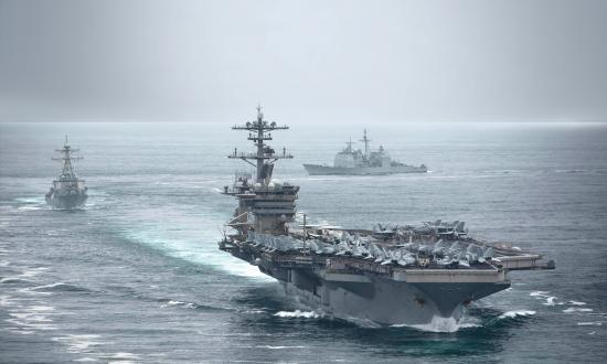 The aircraft carrier USS Theodore Roosevelt (CVN-71), USS Russell (DDG-59), and the USS Bunker Hill (CG-52), transit in formation.