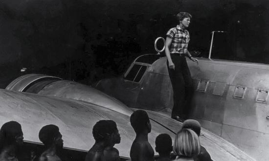 Amelia Earhart alighting from her Electra at Lae