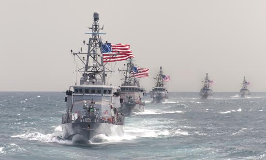 USS Hurricane (PC-3) leading other coastal patrol ships in formation.