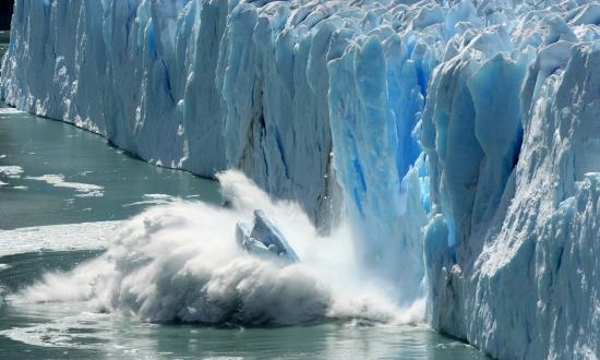 Iceberg falling into the ocean