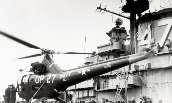 A Sikorsky HO3S-1 helicopter rests on the carrier USS Philippine Sea (CV-47) during the Korean War. These helicopters were flown in large numbers during the conflict for VIP and mail delivery, search and rescue, gunfire spotting—and mine-spotting.