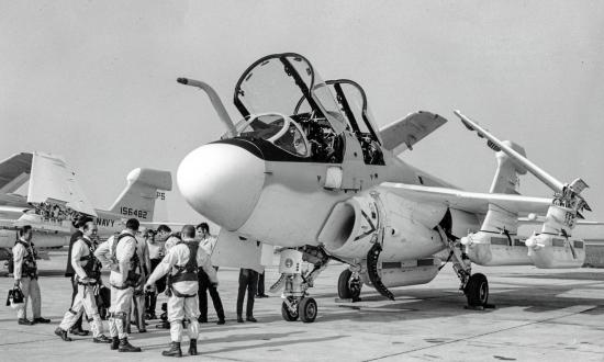 Ground-to-ground left front view of an EA-6B Prowler with crew standing outside