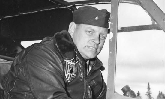 Lt. Cmdr. Frank Erickson seated at the controls of an HNS-1.