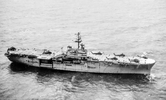 Aerial starboard view of USS Iwo Jima (LPH-2) stadning off the Mekong Delta