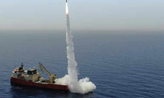 An IAI LORA missile is test-fired from a cargo ship.