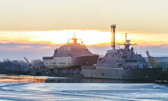 The Navy prepares to christen the future littoral combat ship USS St. Louis (LCS-19), left, in Marinette, Wisconsin, as the USS Billings (LCS-15) is under construction and preparing for commissioning.