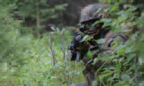 U.S. Navy Corpsman posts security during a patrolling exercise at Joint Base Elmendorf-Richardson, Anchorage, Alaska