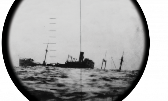 A sinking Japanese ship seen through the periscope of a U.S. submarine.
