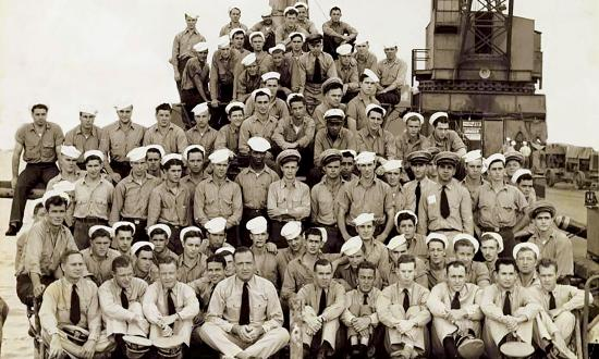 Crew of the USS Seahorse posing on their submarine