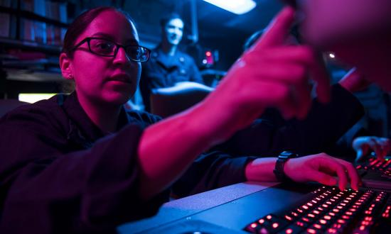 Cryptologic Technician (Collection) 3rd Class Ambar Morales-Diaz analyzes data aboard the aircraft carrier USS Theodore Roosevelt (CVN-71)