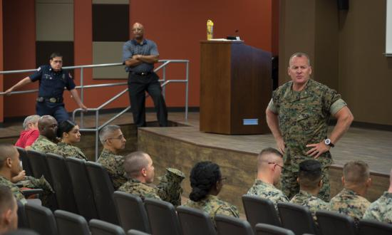 Col. Martin, USMC, conducting a safety standdown in an auditorium in 2017